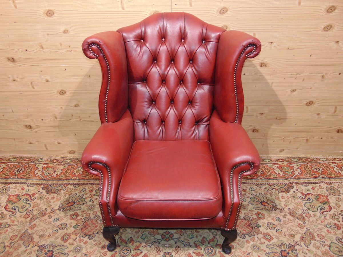 Red Chesterfield armchair
