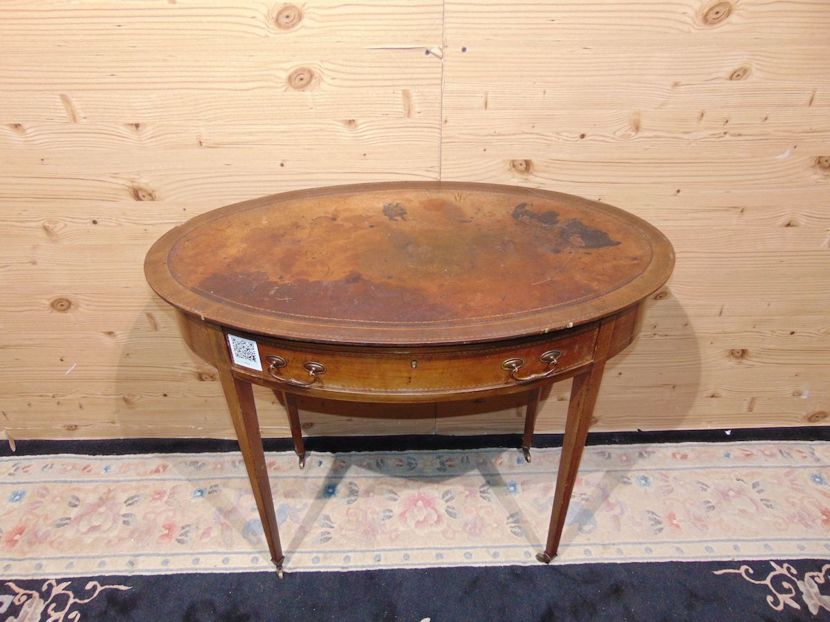 Oval coffee table inlaid with leather 2236..jpg