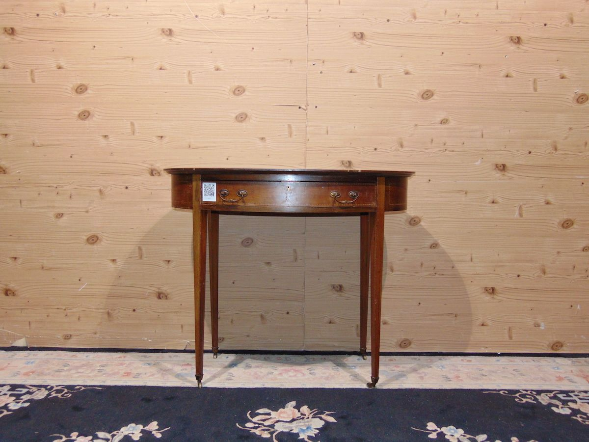 Oval coffee table inlaid with leather 2236.jpg