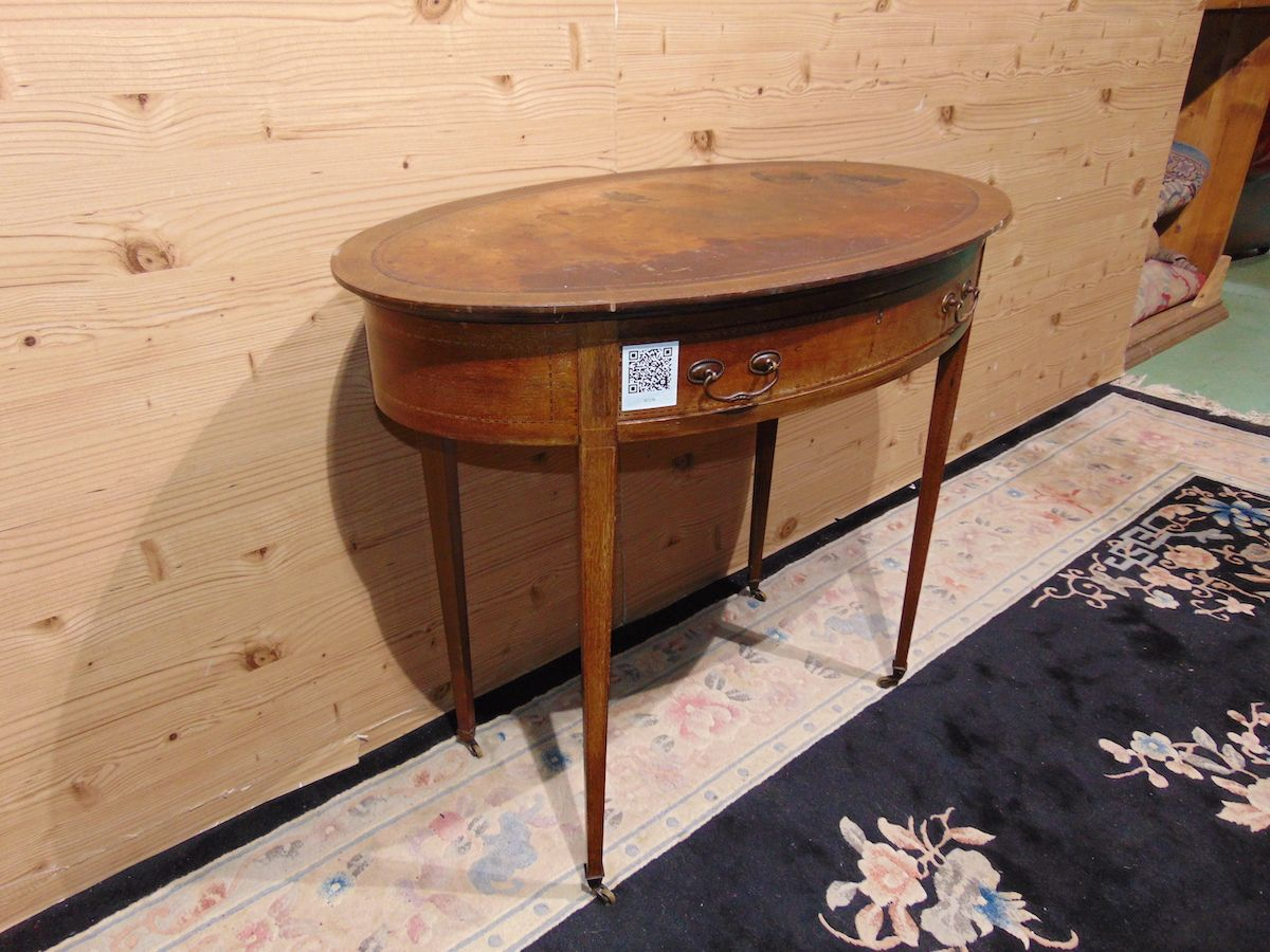 Oval coffee table inlaid with leather 2236...jpg