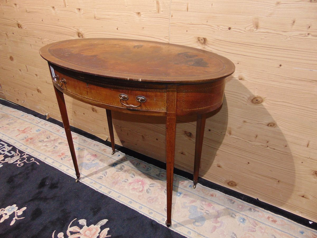 Oval coffee table inlaid with leather 2236....jpg